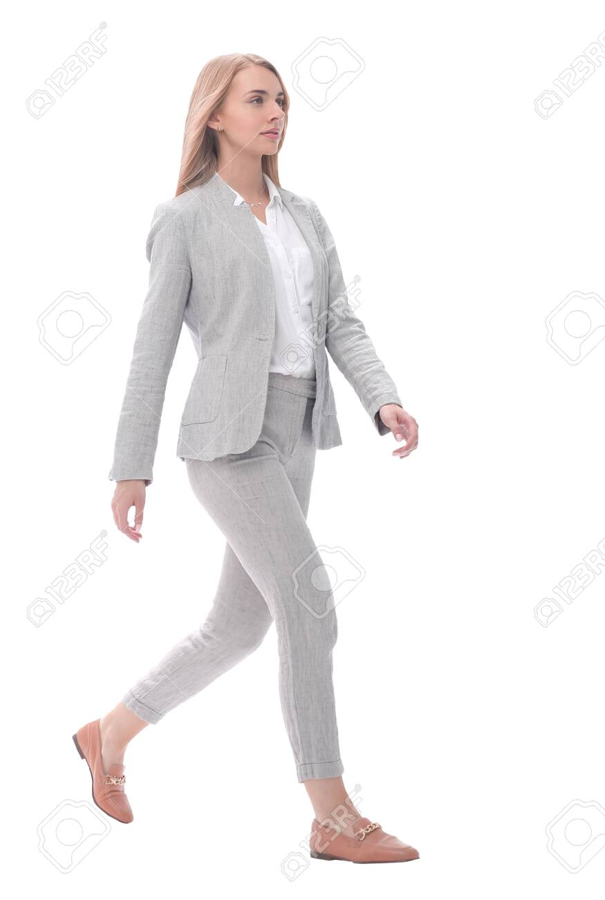 serious young businesswoman stepping forward.isolated on white - 130469451