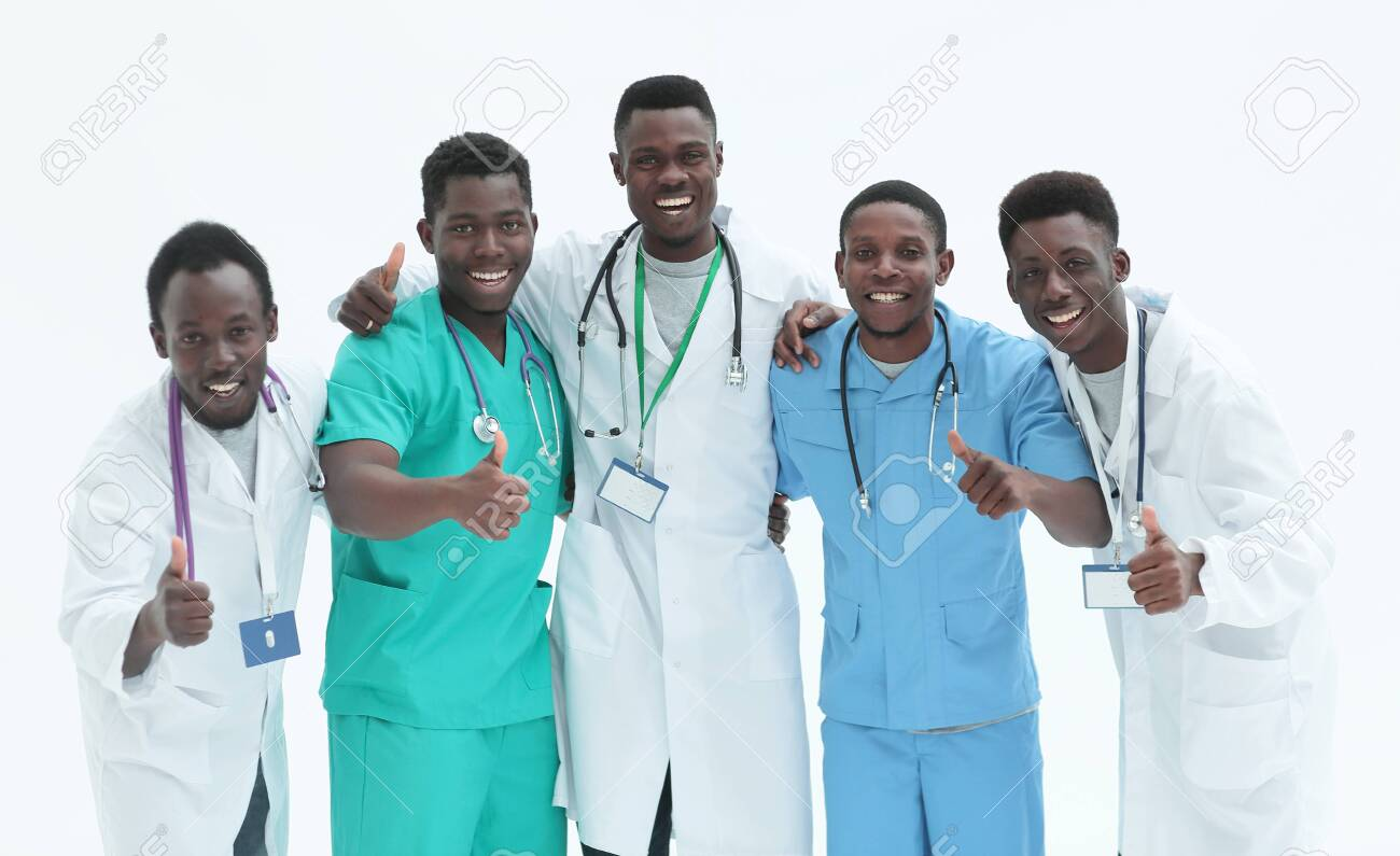 smiling interns doctors giving thumbs up. isolated on white - 136935540
