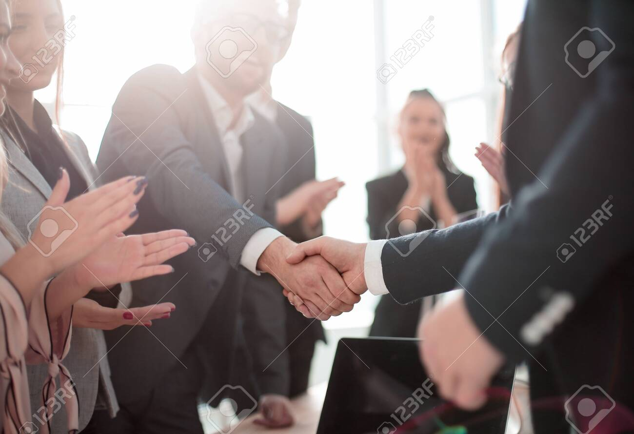 business partners shaking hands standing in the office. concept of partnership - 137869003