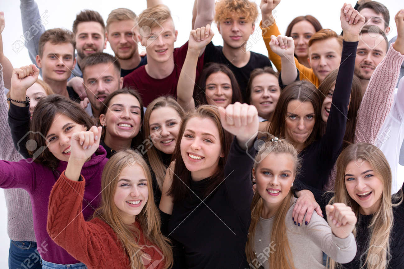 large group of friends with a smile looking at the camera - 146174861