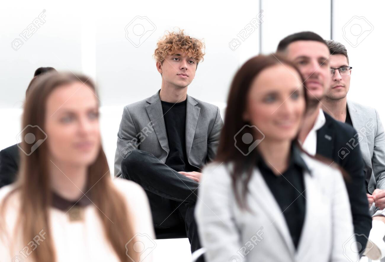 group of employees sitting in a conference room. - 149611702