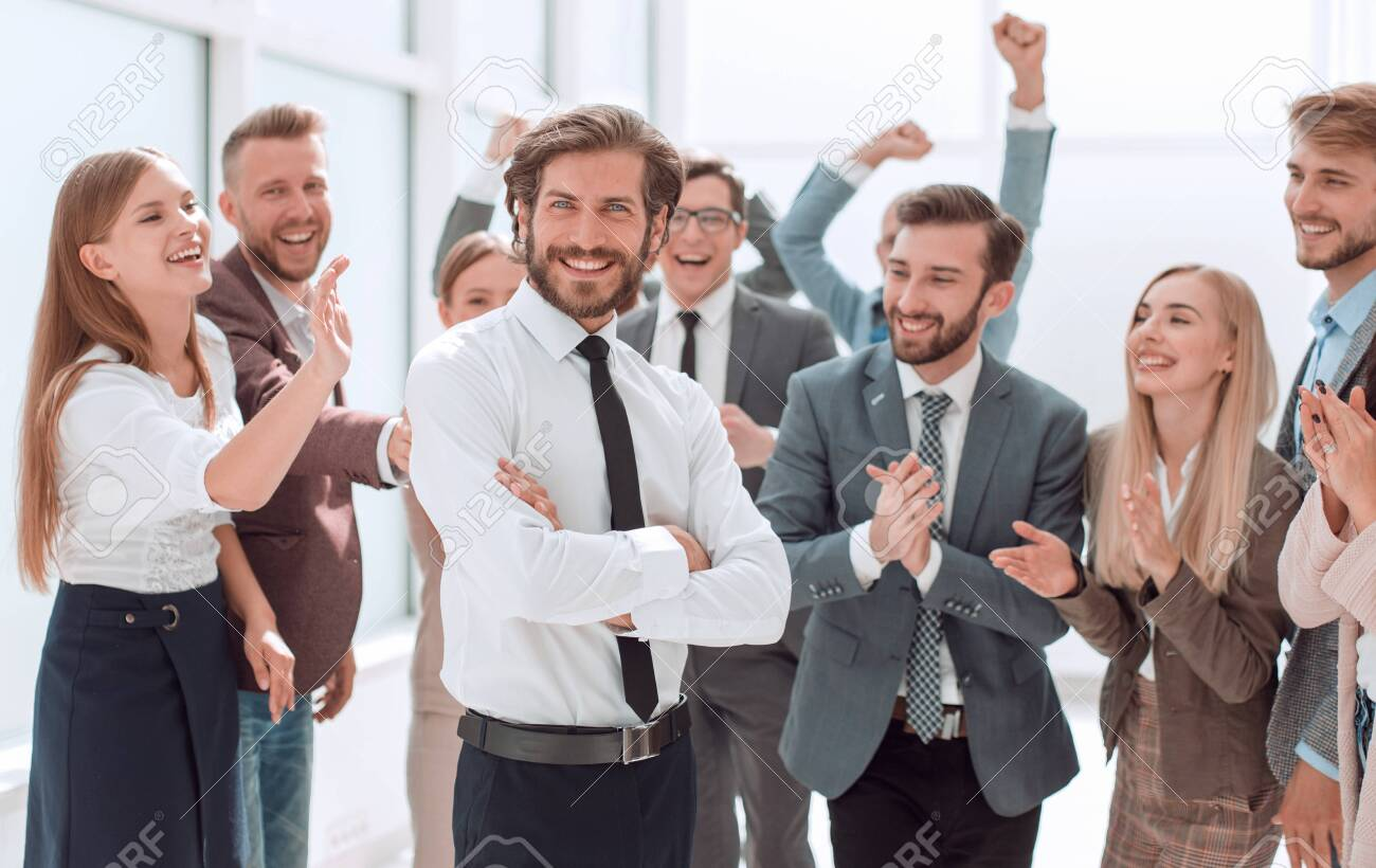 confident young businessman standing in front of a happy busines - 158076932