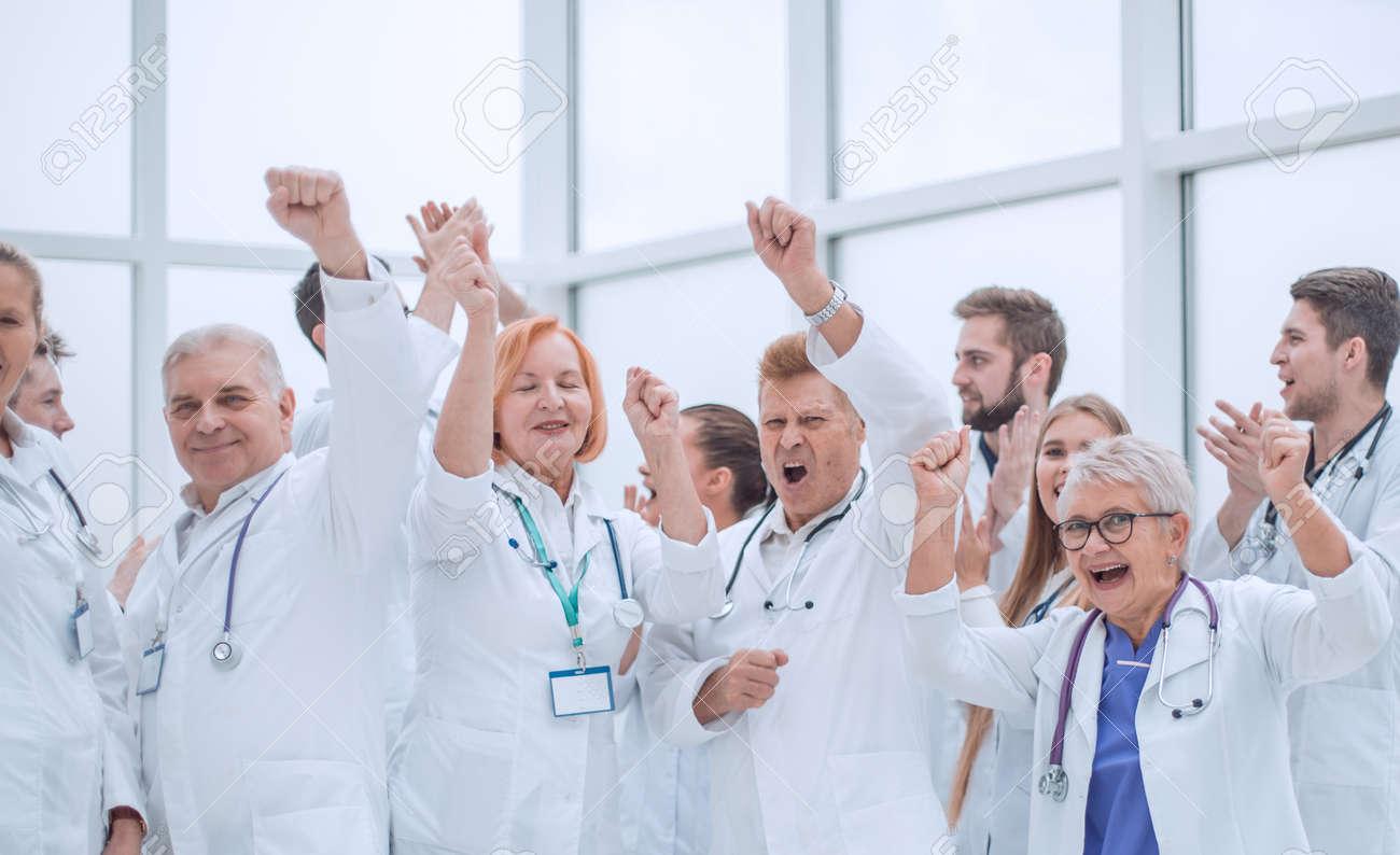 large group of diverse doctors celebrating together. - 165103534
