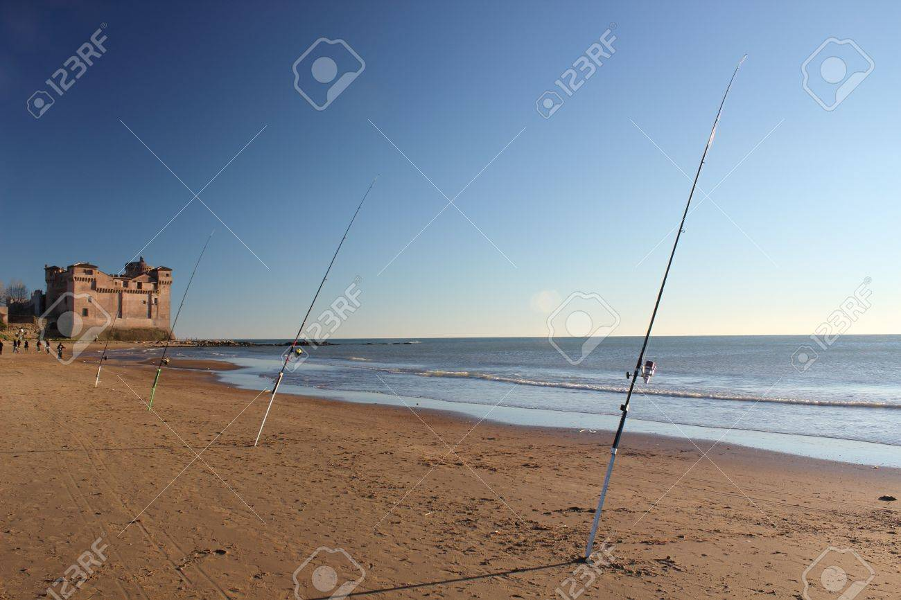 Some Fishing Rods At Santa Severa Beach In Front Of Famous Castle