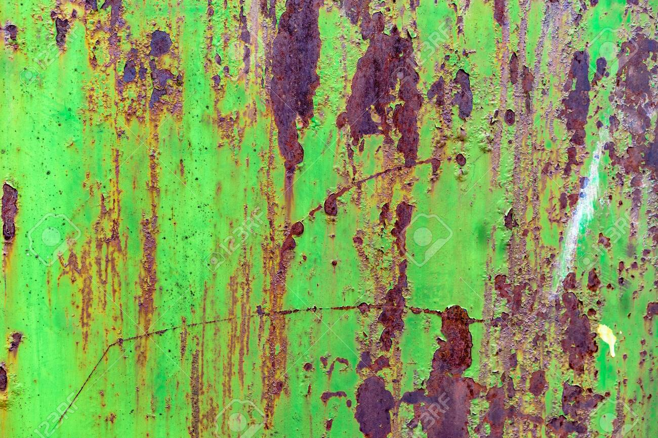 Detail of green painted, old, metal, rusty doors. Grunge texture of green rusty metal with scratches - 120613952