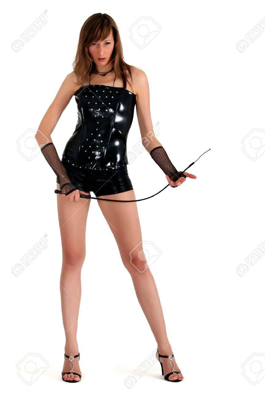 dominatrice sexy en cuir verni avec fouet Banque d'images - 4551975