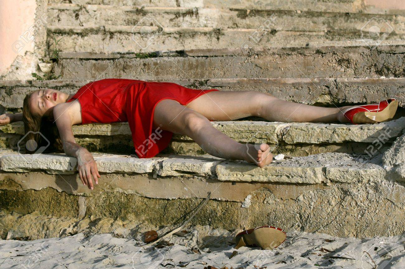 woman playing dead, lying on the stairs Stock Photo - 4552281