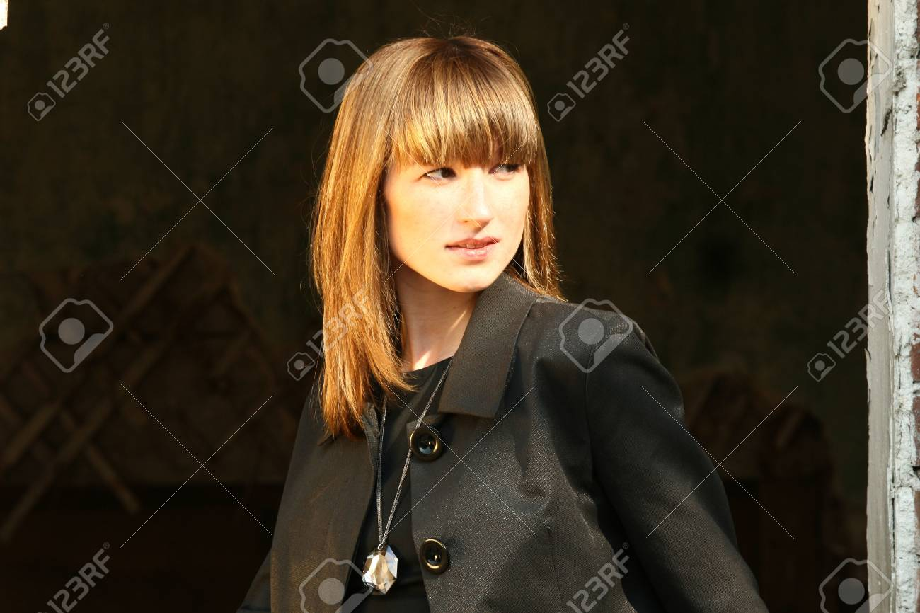 Woman in business dress posing outdoor Stock Photo - 4830510