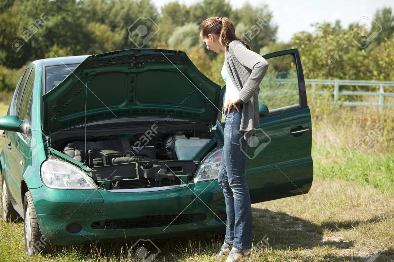 woman with a broken car Stock Photo - 5442475