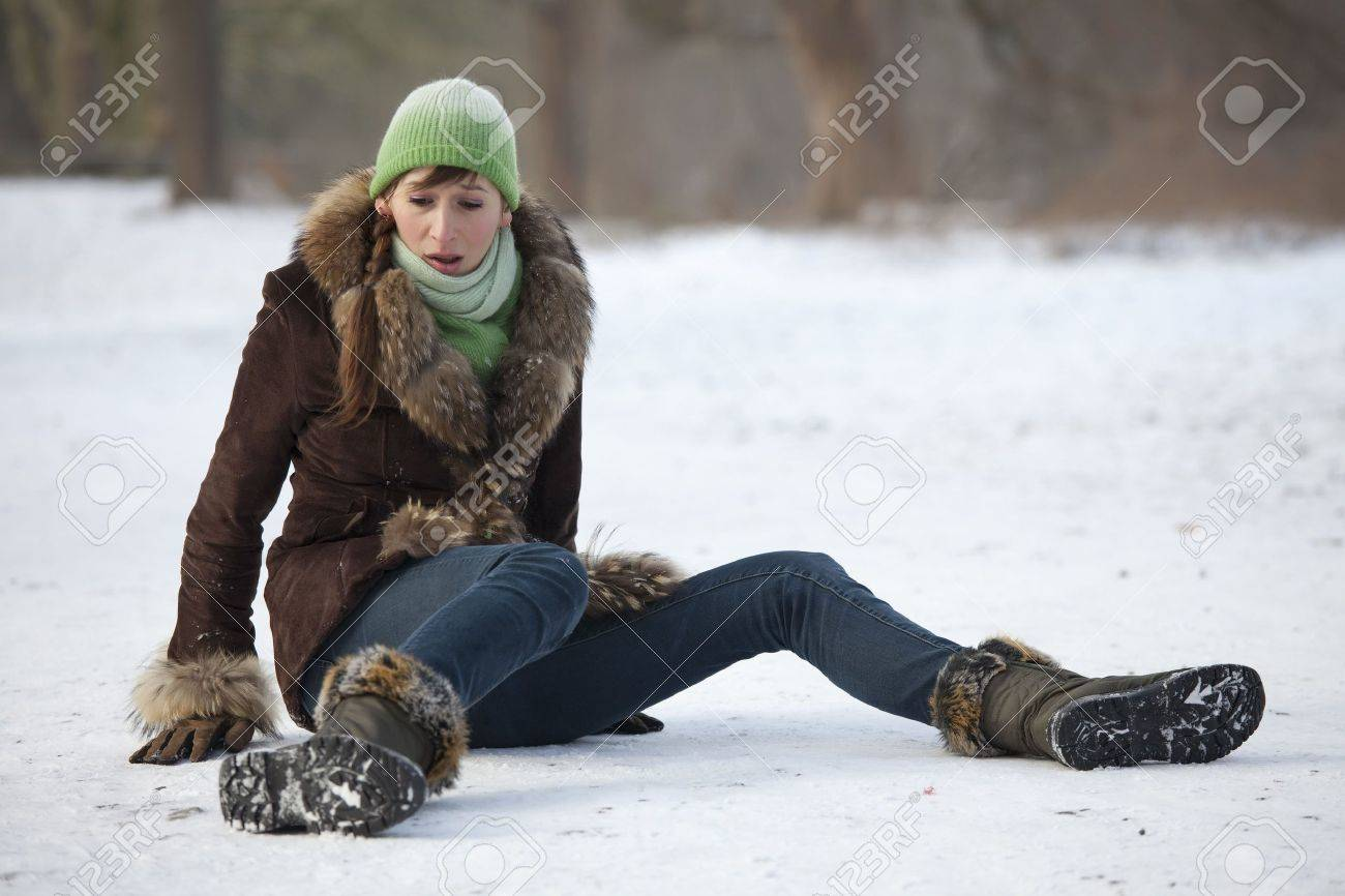 woman slips and falls down on snowy road - 6175095
