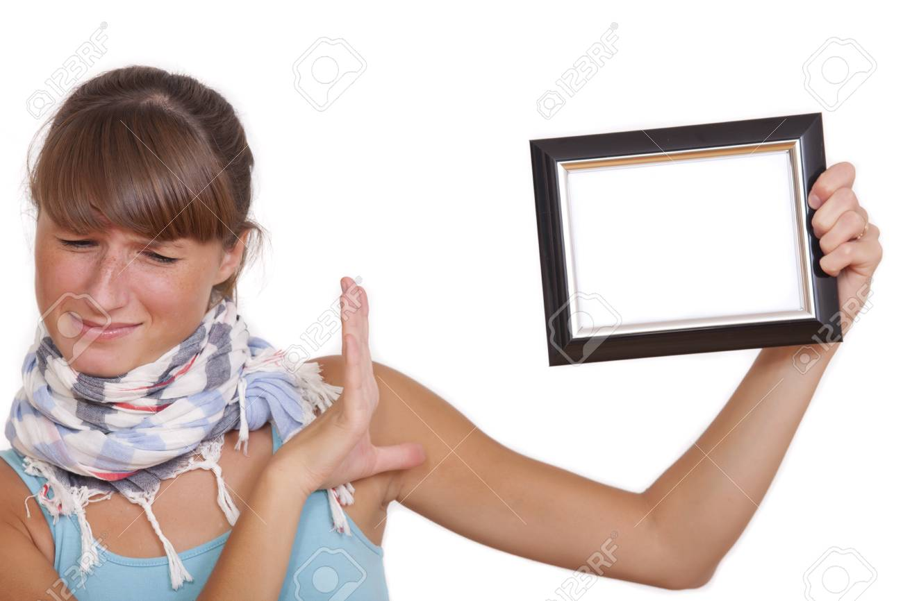 unhappy woman with photo frame - isolated over white background Stock Photo - 7826188