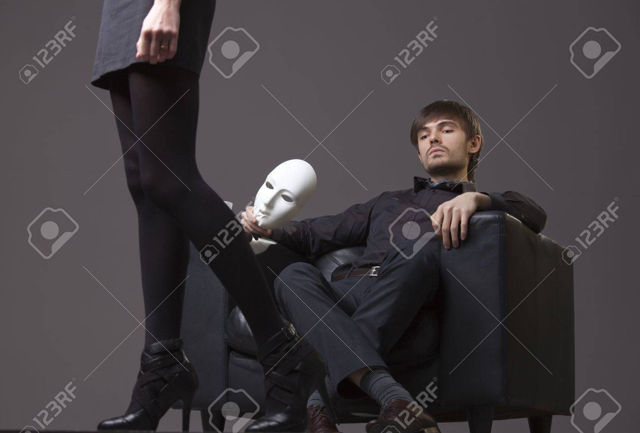 relationship conflict - man with mask treats woman with contempt Stock Photo - 8820961