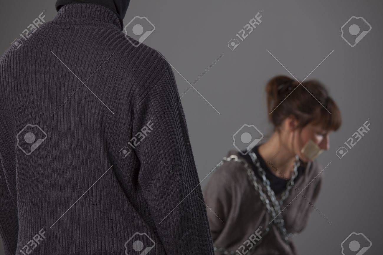 kidnapped woman and punisher - focus on male sweater Stock Photo - 8905550