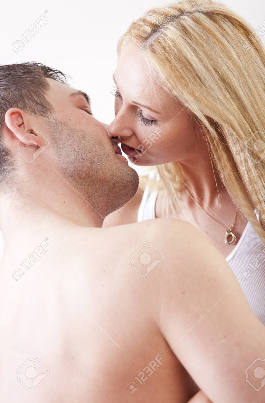 Romantic couple in bed kissing Stock Photo - 13136959