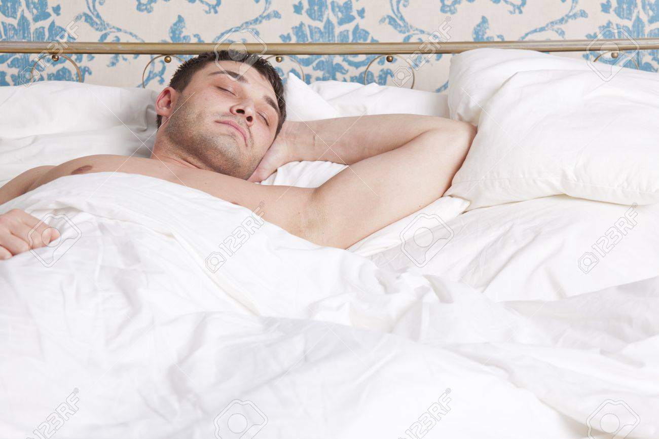 man sleeping alone in bed Stock Photo - 13135863