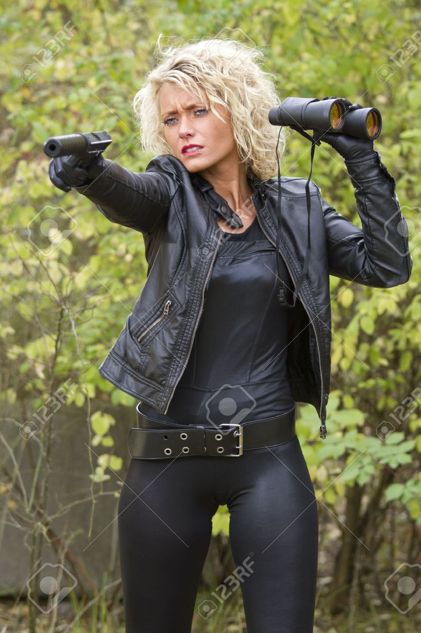 Ladies leather shooting gloves - Stock Photo Woman In Leather Outfit Shooting From A Silencer Handgun Outdoor