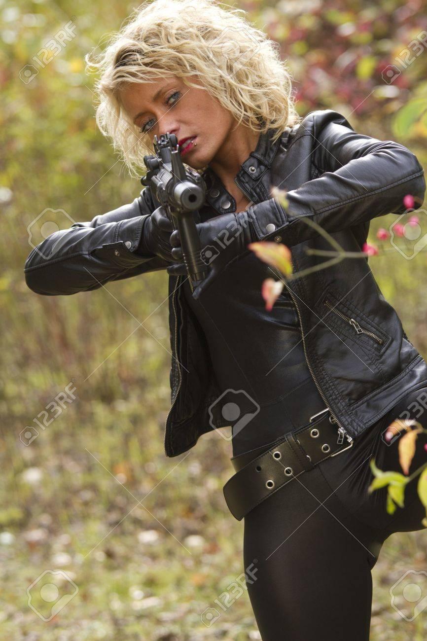 Woman with machine gun Stock Photo - 15981518