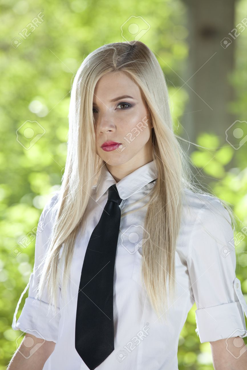 Portrait Of Young Woman In White Shirt And Tie Posing Outdoor ...