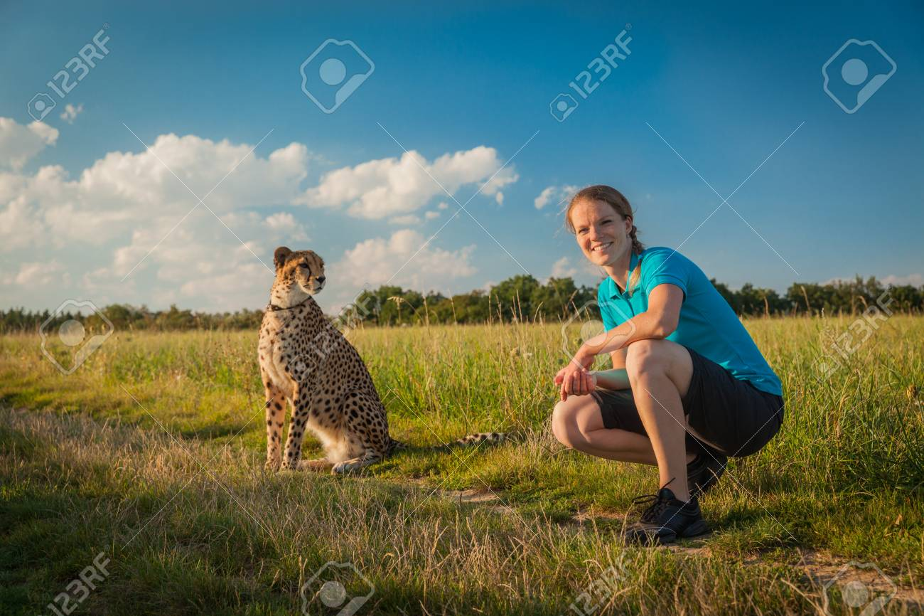 Young Woman On A Green Meadow In Summer Walking Cheetah Stock Photo Picture And Royalty Free Image Image 62487686