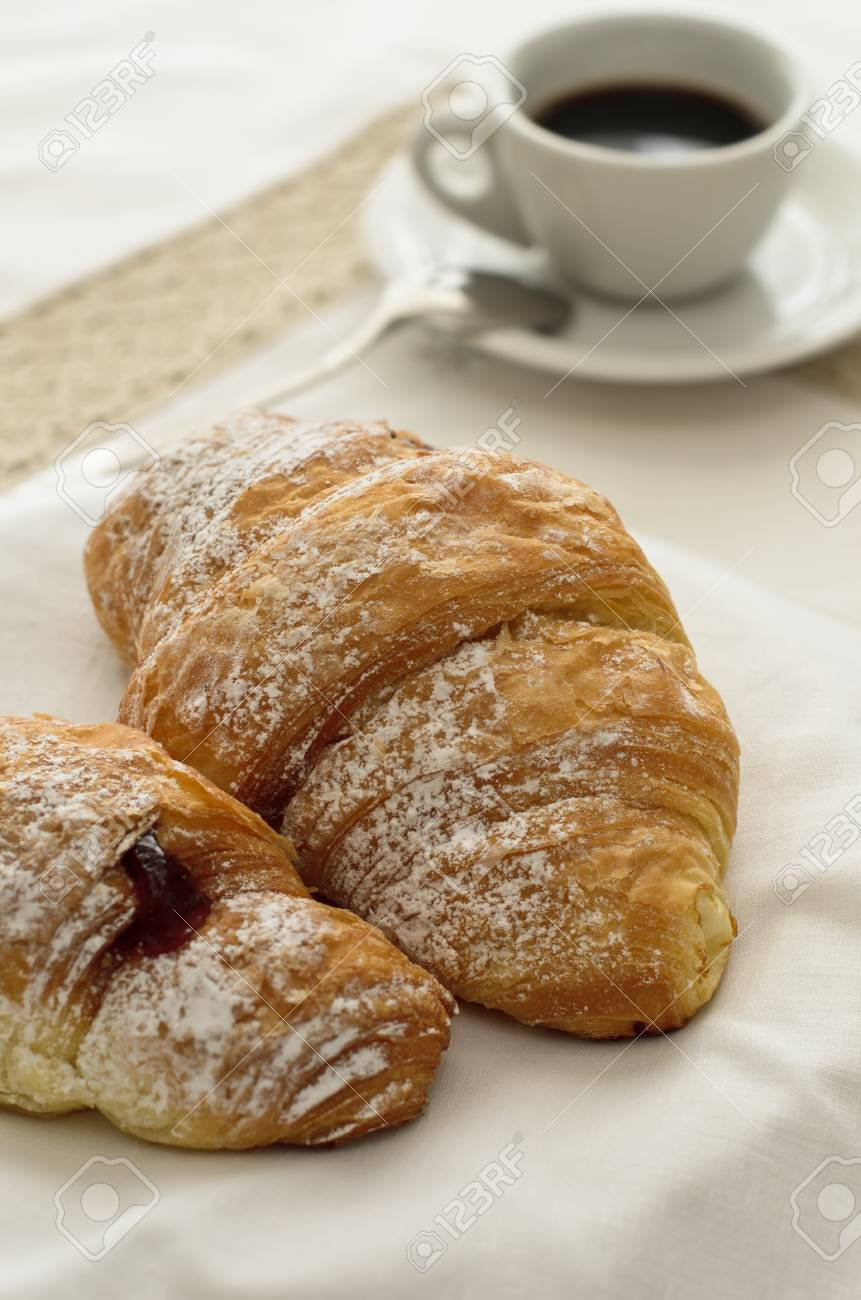 Croissant with a drop of strawberry marmelade Stock Photo - 14239341