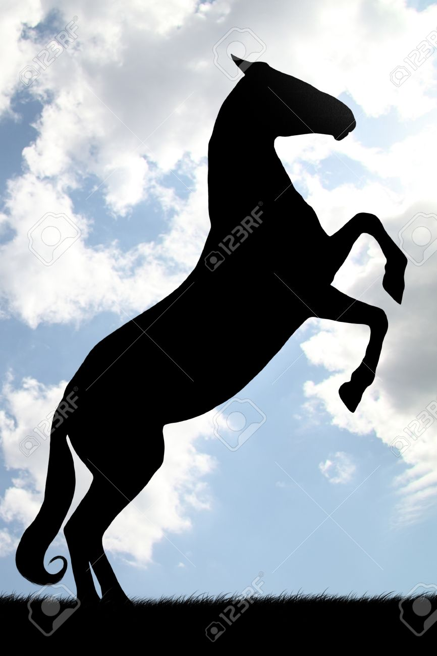 Black silhouette of rearing horse against sky Stock Photo - 12956717
