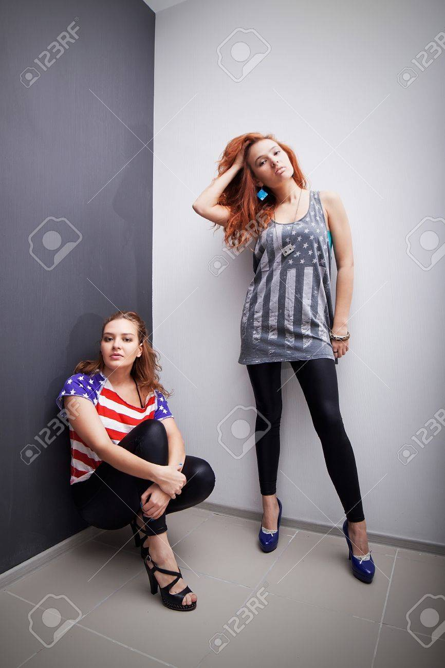 Two beautiful girls wearing T-shirts with American flag Stock Photo - 17414553