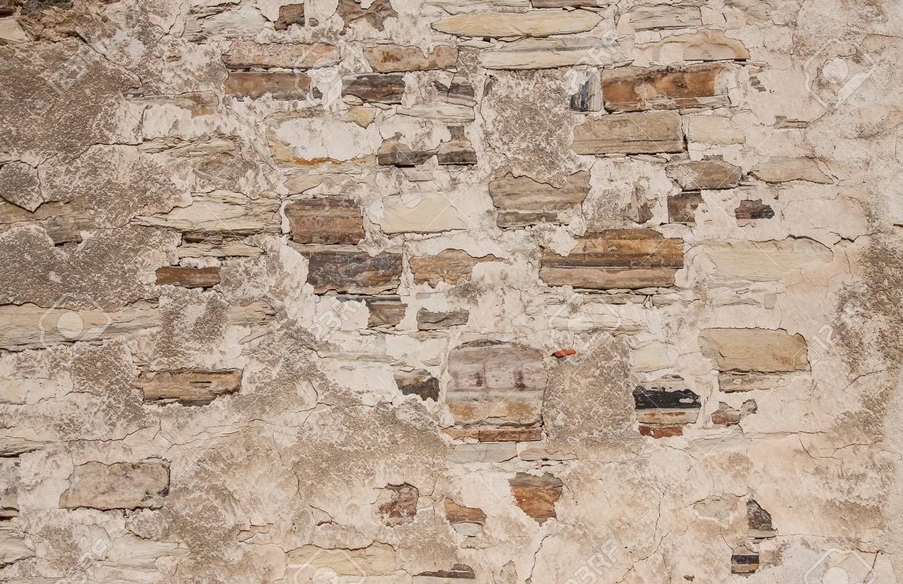 Natural stone wall background, house facade