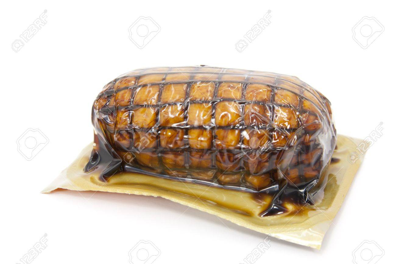 Roast vacuum packaged and tied with white background Stock Photo - 12860702