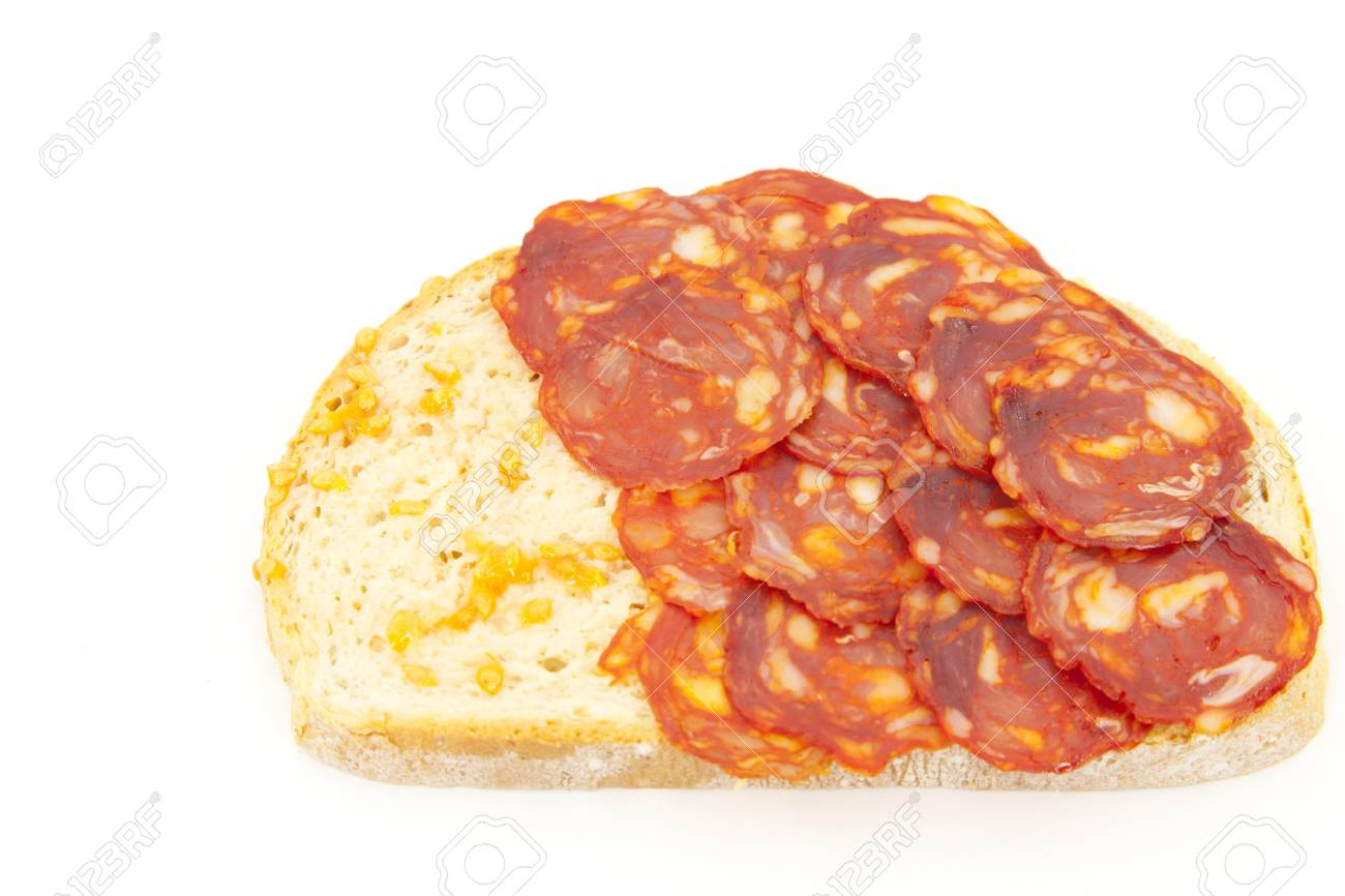 Bread with tomato and sausage Iberico on a white background Stock Photo - 13060538