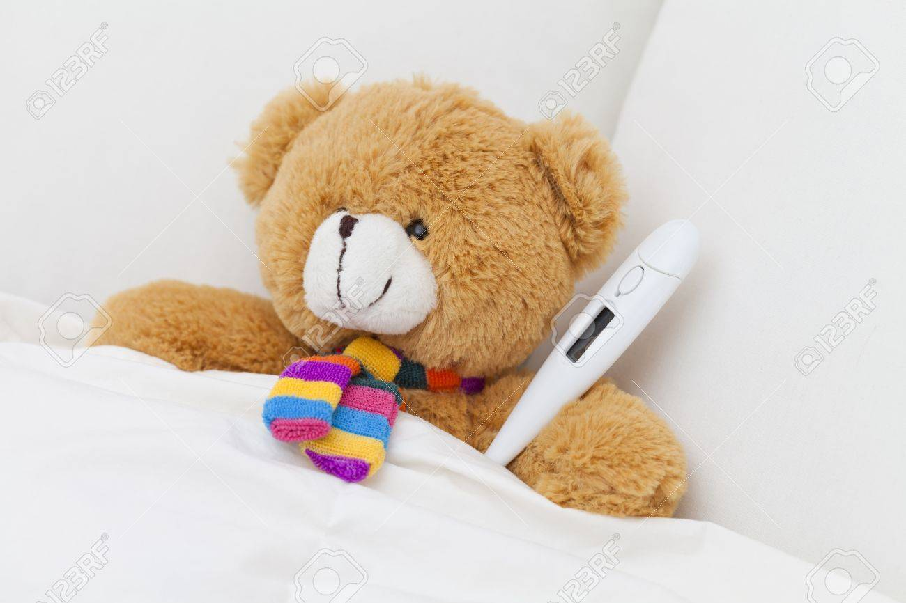 Teddy bear taking cold temperature in bed stock photo picture and stock photo teddy bear taking cold temperature in bed altavistaventures Images
