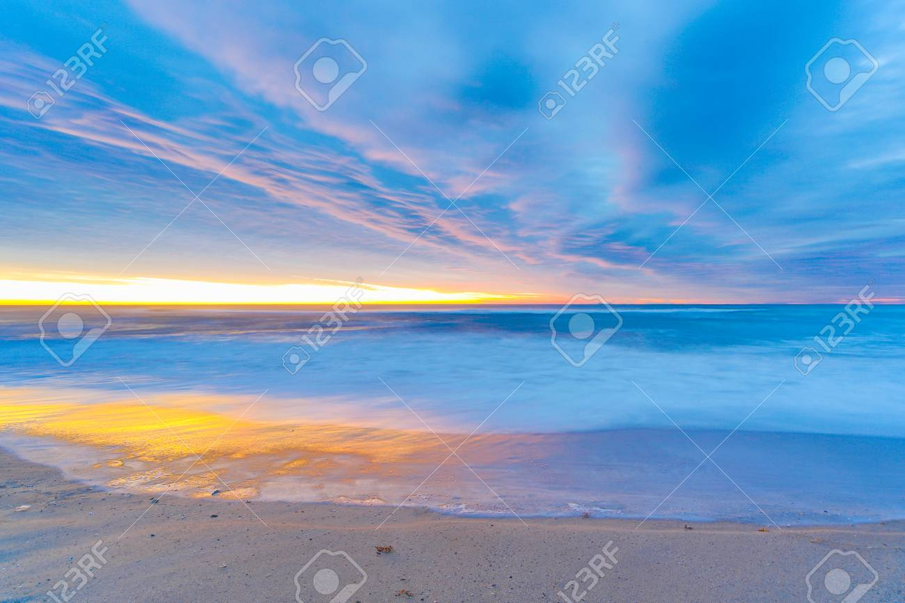 Sunrise on the beach on a winter day in Barcelona Stock Photo - 24963078