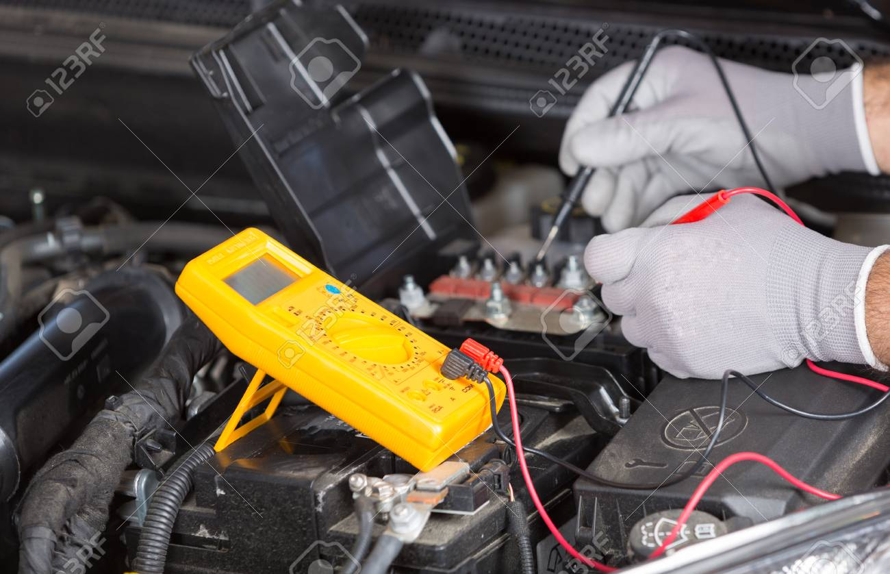 Car Mechanic With A Tester Performing An Electrical Test Stock Photo 44042315