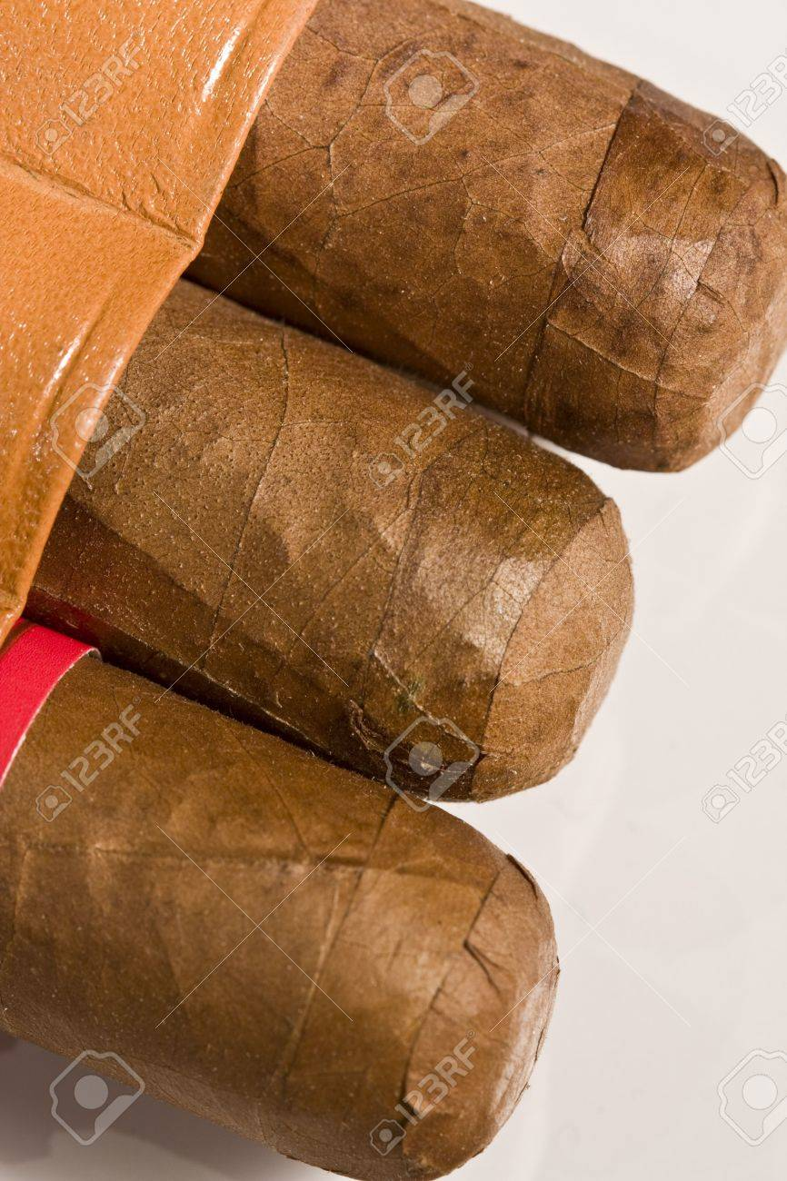 Three pure Havana cigars beginning to show from the tobacco pouch