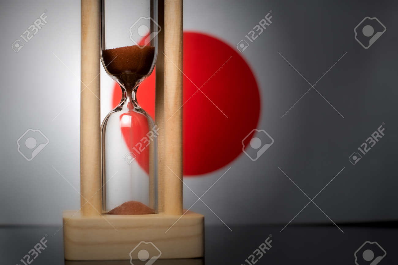 Hourglass and Japan flag, soft focus, copy space - 152379278
