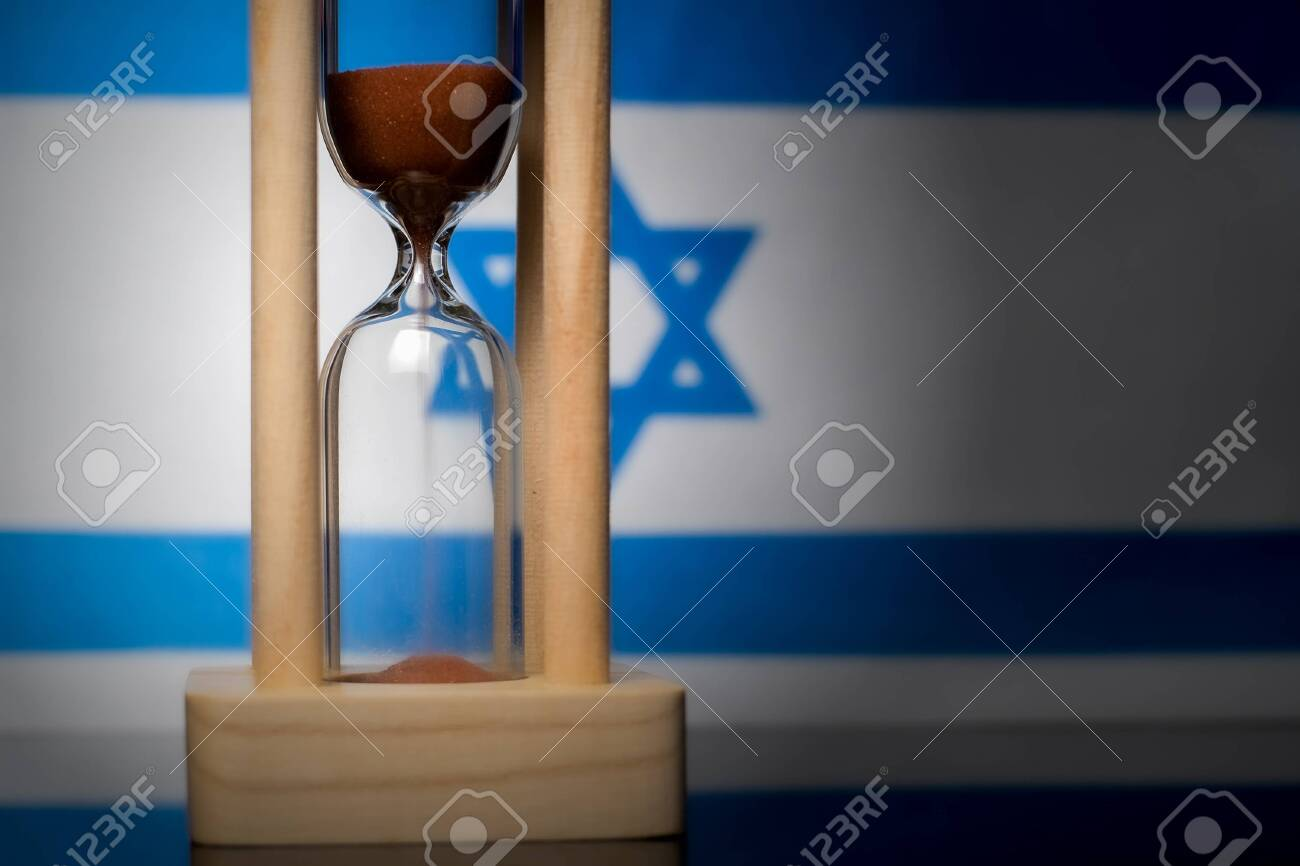Hourglass and Israel flag, soft focus, copy space - 152379279