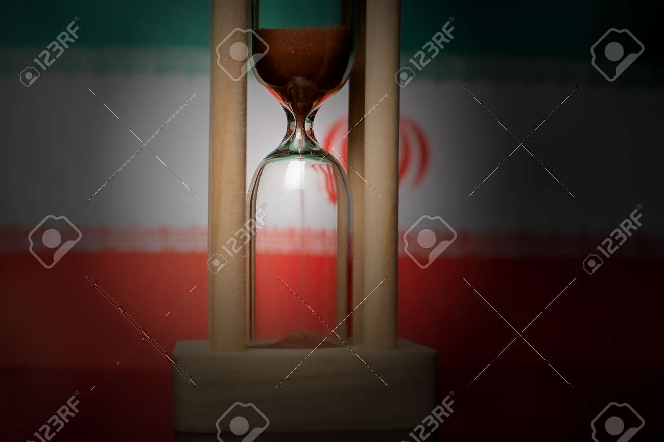 Hourglass and Iran flag, soft focus, copy space - 152379280