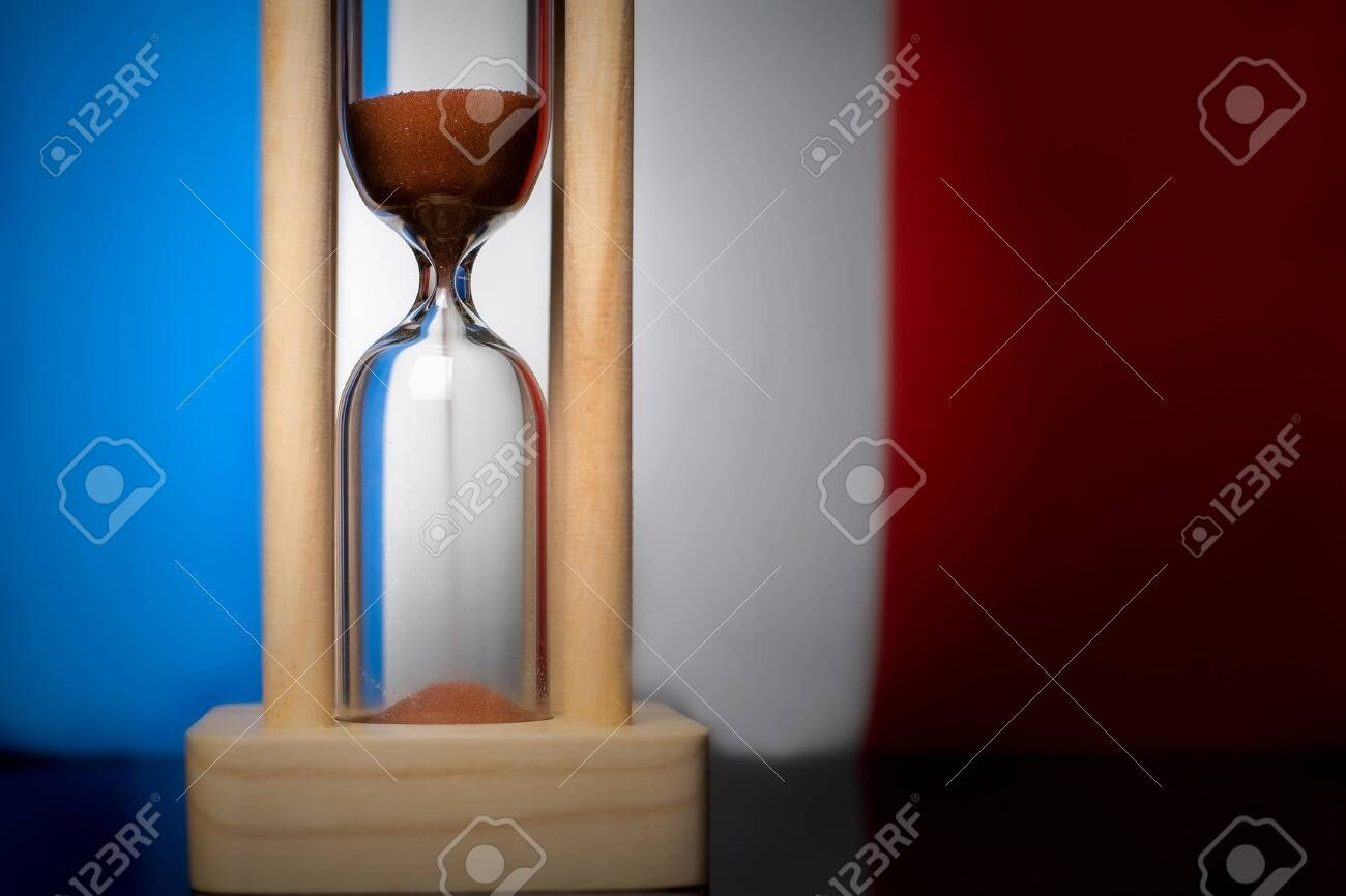Hourglass and France flag, soft focus, copy space - 152379484