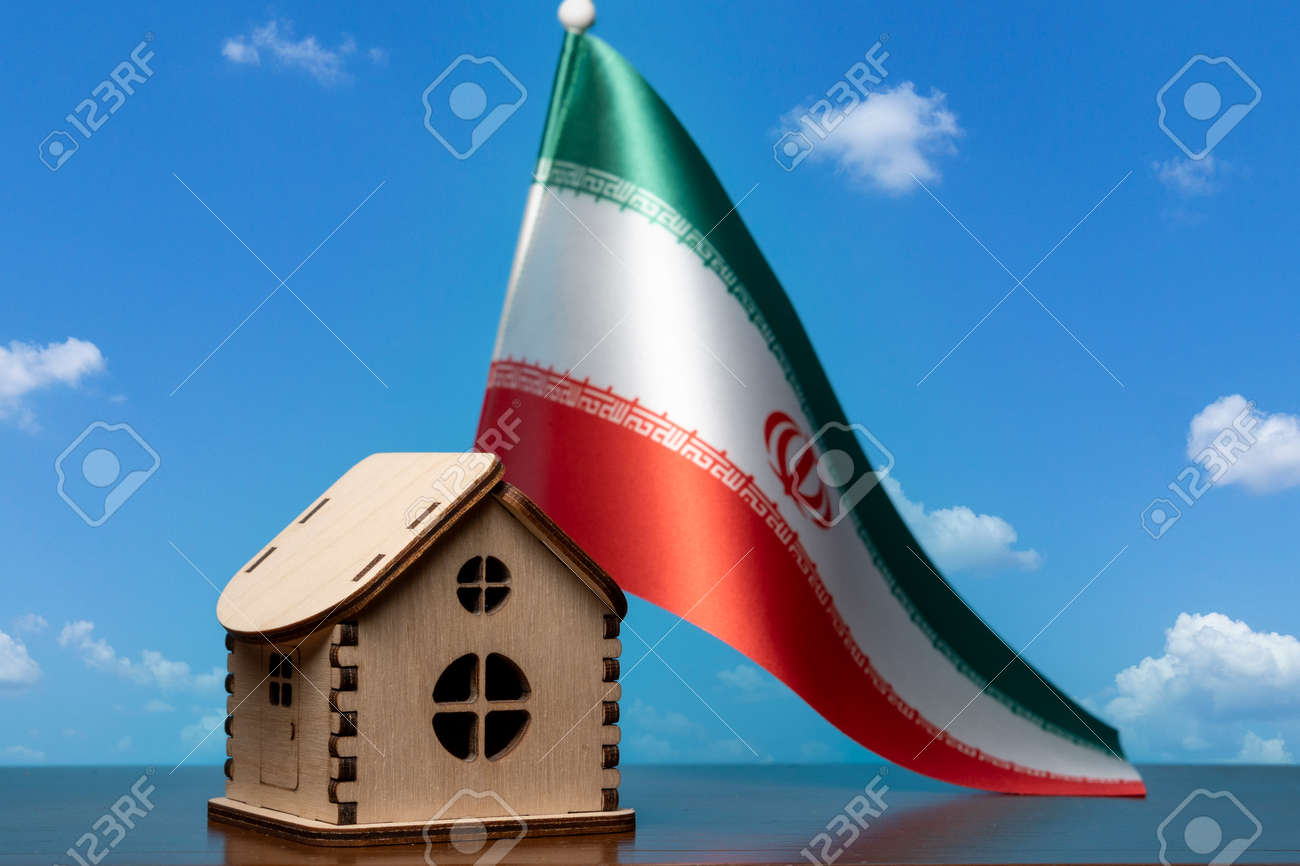 Small wooden house and Iran flag, sky on background. Real estate concept, copy space - 163114083