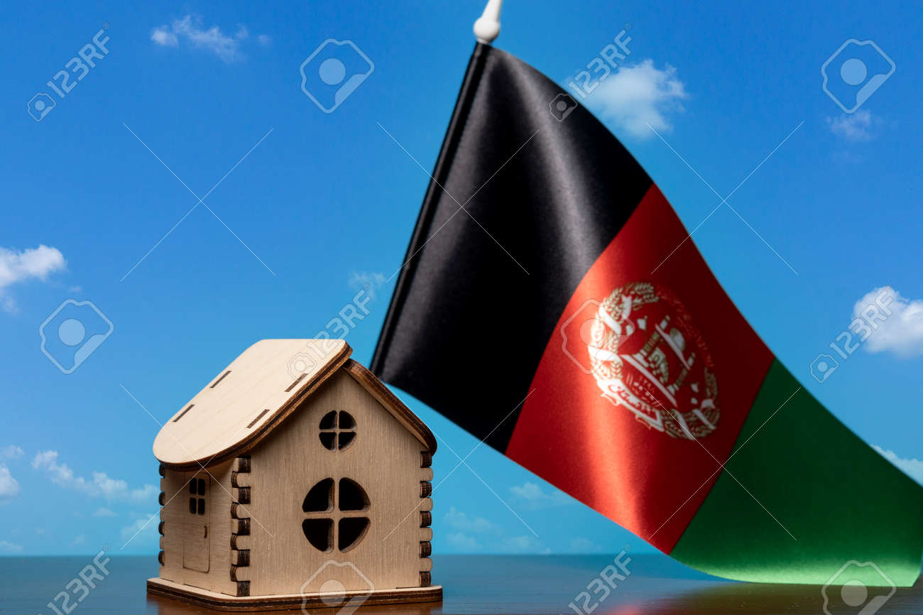 Small wooden house and Afghanistan flag, sky on background. Real estate concept, copy space - 163114086