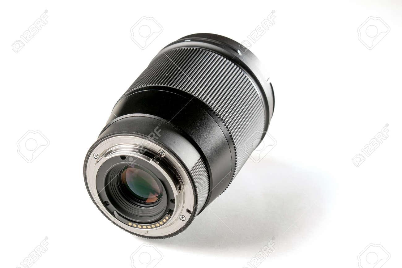 Professional photo camera zoom lens on white background - 163286380
