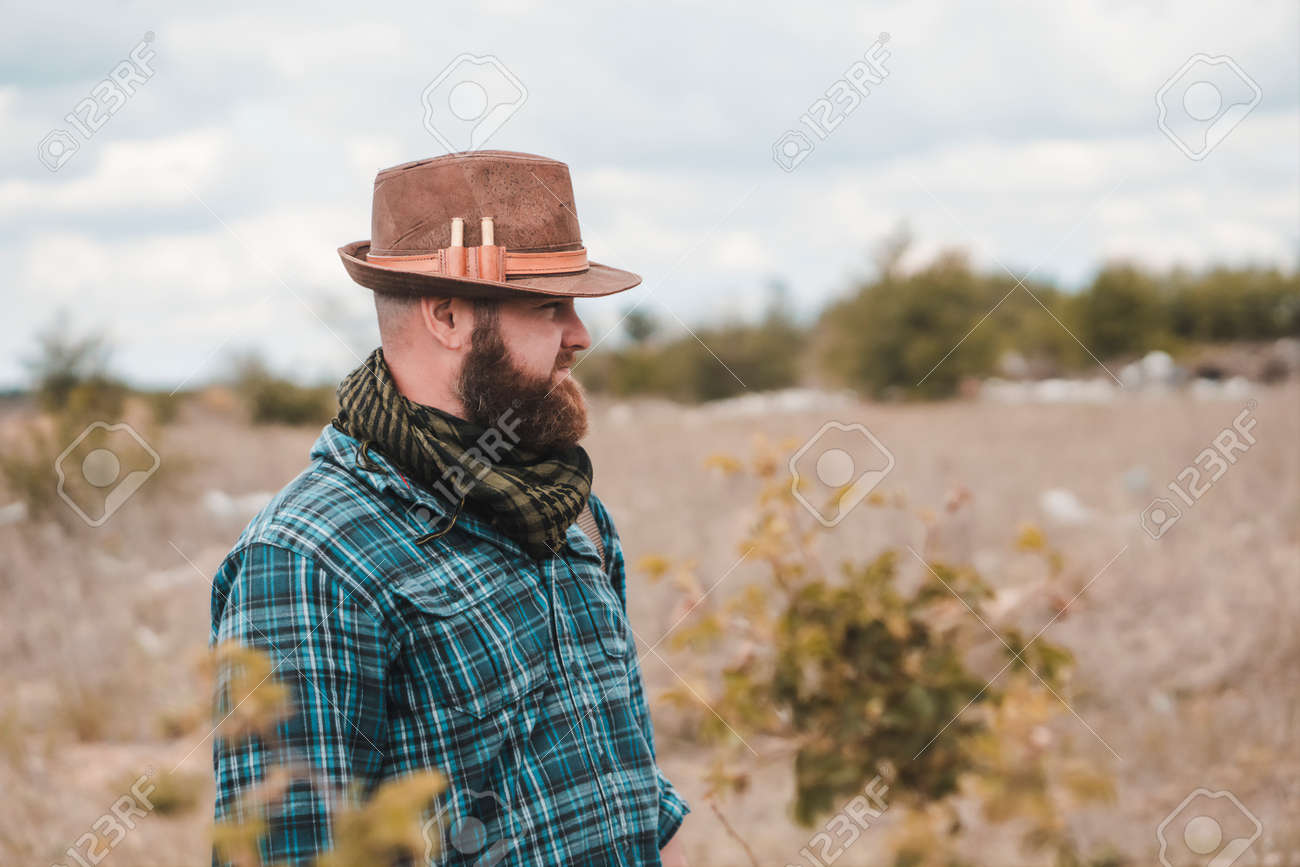 Portrait of a young bearded man in a hat - 164160316