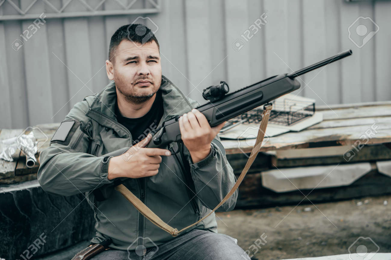 Private military contractor or hunter looking on the range - 164160335