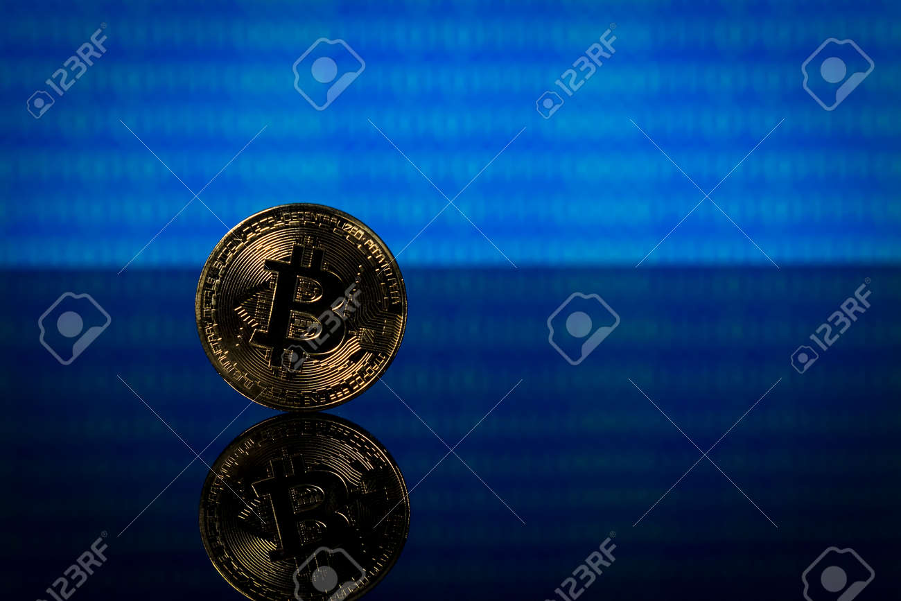 Golden bitcoin, binary code on a blue background - 163725239