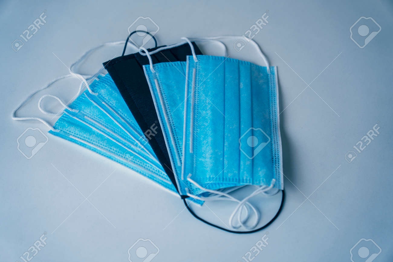 Surgical masks to protect against virus. virus spread protection. Blue and black masks. Soft focus - 165362608