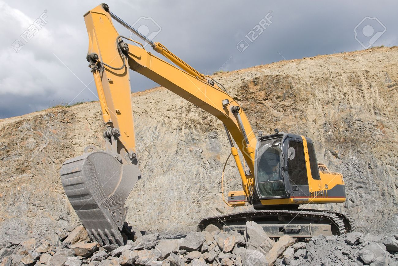 large bulldozer excavator with rocks stock photo picture and
