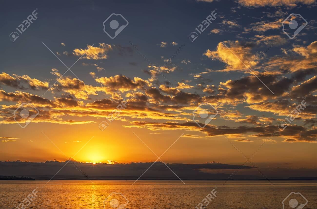 Beautiful ocean landscape with vibrant sunset or sunrise - 121355045