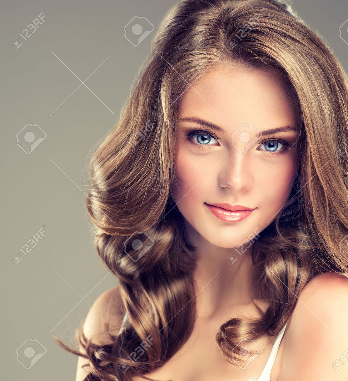 Smiling Beautiful Girl, Brown Hair With An Elegant Hairstyle ...