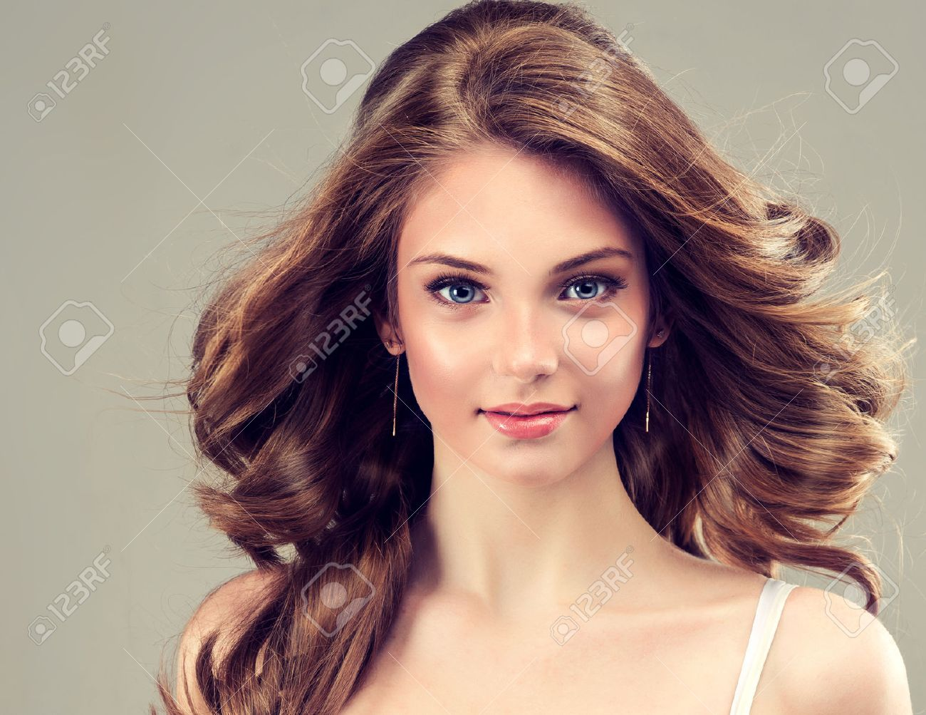 smiling beautiful brown hair with an elegant hairstyle