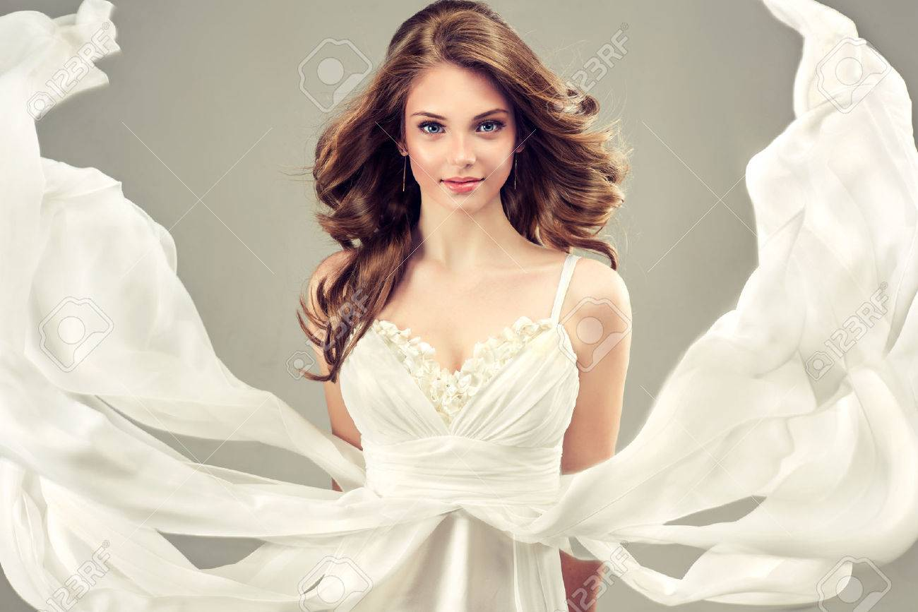 Girl Model In A White Wedding Dress With Elegant Hairstyle Stock ...