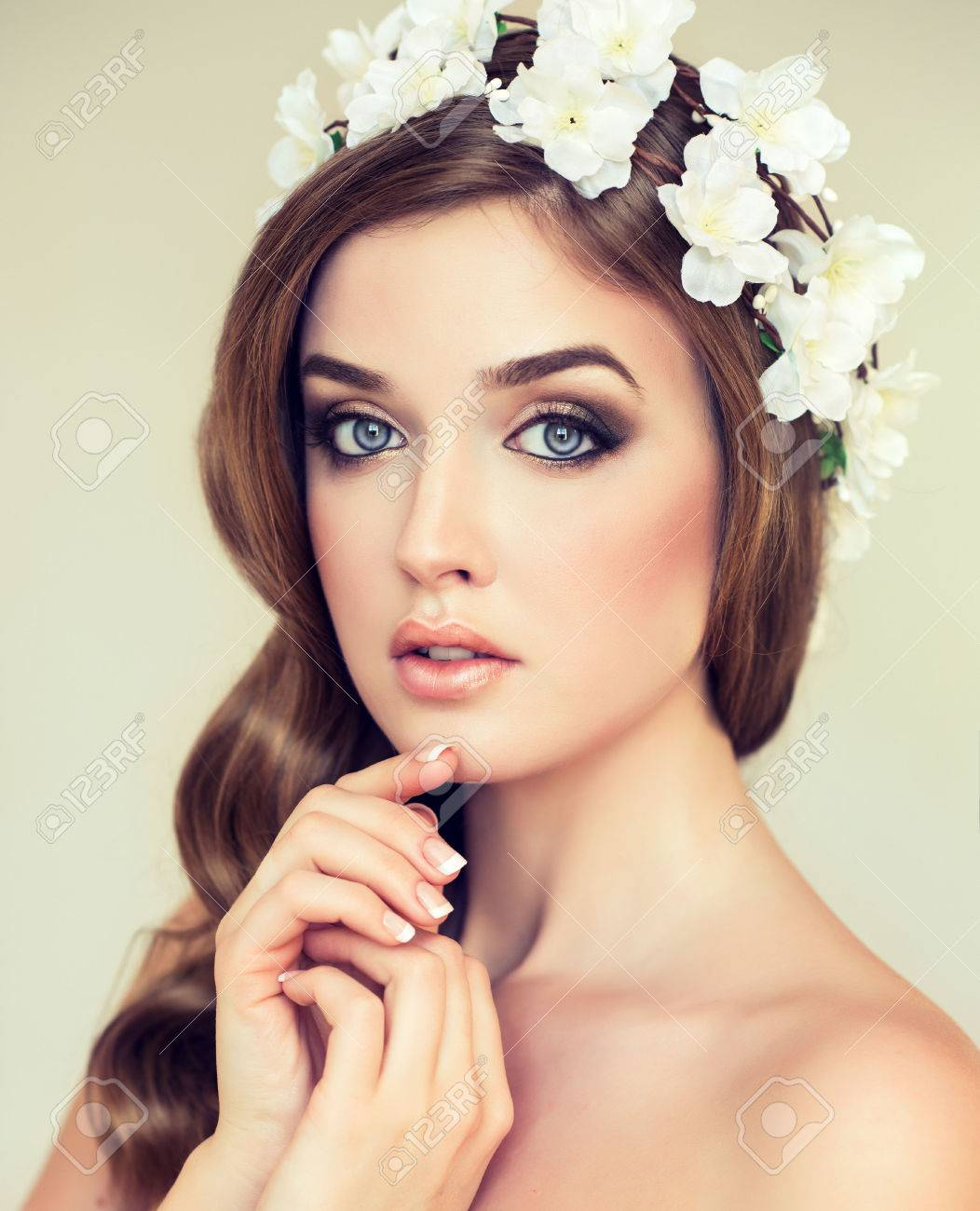 Spring freshness girl with delicate pastel flowers in hair wreath girl with delicate pastel flowers in hair wreath of white flowers stock photo mightylinksfo